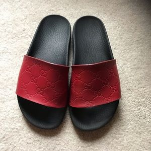 Red leather Gucci slides